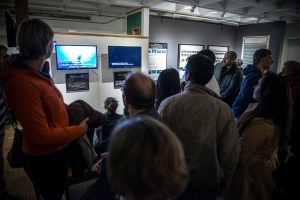 Visitors gather to watch slow-motion video clips of marine organisms. Courtesy of Chris Welch.
