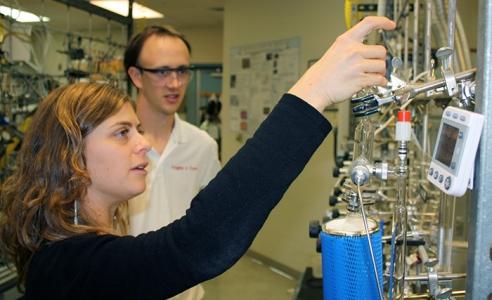 Chris Follett and collaborator Chiara Sanitelli, a visiting scientist from the Institute of Biophysics in Pisa, Italy, process deep ocean samples for radiocarbon measurements. Credit: Dan Repeta, WHOI