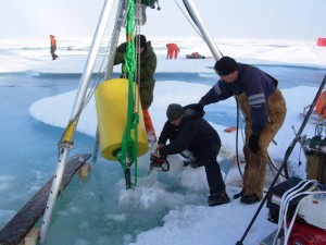 Researchers recover an ITP from the Arctic Ocean. The ITP program is supported by the National Science Foundation and the Office of Naval Research. (Courtesy of John Toole, WHOI)