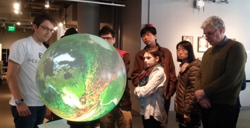 Visitors gather around the iGlobe to learn about ocean circulation. Credit: Cassie Martin