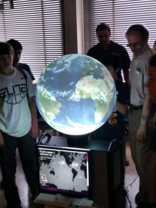 Flierl teaches a group of middle school students about ocean plastics using the iGlobe. (Credit: John Marshall)