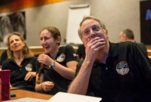 New Horizons co-investigator and EAPS planetary scientist Richard Binzel, and EAPS graduate student Alissa Earle react to seeing Pluto in detail for the first time. Photo Credit: (NASA/Bill Ingalls)